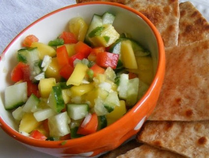 Cucumber mango salsa takes 5 min to make and is the perfect topping for anything